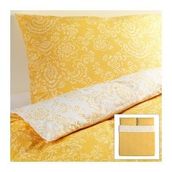 "ÅKERTISTEL duvet cover and pillowcase(s), yellow Duvet cover length: 86 "" Duvet cover width: 102 "" Pillowcase length: 20 "" Duvet cover length: 218 cm Duvet cover width: 259 cm Pillowcase length: 51 cm"