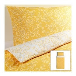 "ÅKERTISTEL duvet cover and pillowcase(s), yellow Duvet cover length: 86 "" Duvet cover width: 64 "" Pillowcase length: 20 "" Duvet cover length: 218 cm Duvet cover width: 162 cm Pillowcase length: 51 cm"
