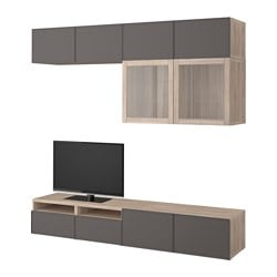 BESTÅ TV storage combination/glass doors, grey stained walnut effect Grundsviken, dark grey clear glass