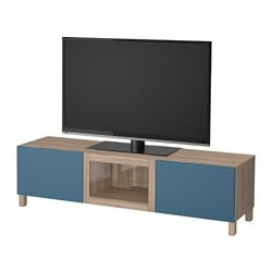 "BESTÅ TV unit with drawers and door, walnut effect light gray Valviken, dark blue clear glass Width: 70 7/8 "" Depth: 15 3/4 "" Height: 18 7/8 "" Width: 180 cm Depth: 40 cm Height: 48 cm"