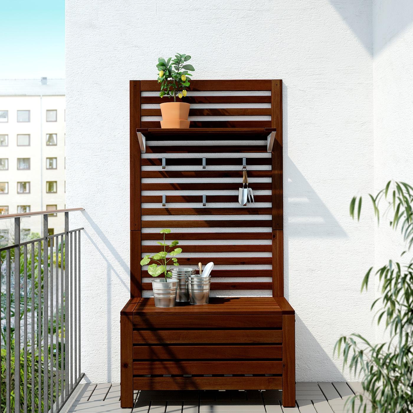 ÄPPLARÖ Bench w wall panel+ shelf, outdoor - brown stained 7x7x7 cm