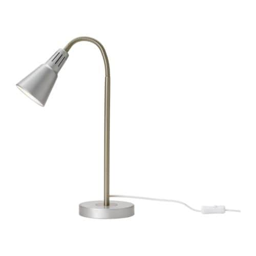 KVART Work lamp IKEA Adjustable arm for easy directing of light.  Directed light; gives a good concentrated beam of light for reading.