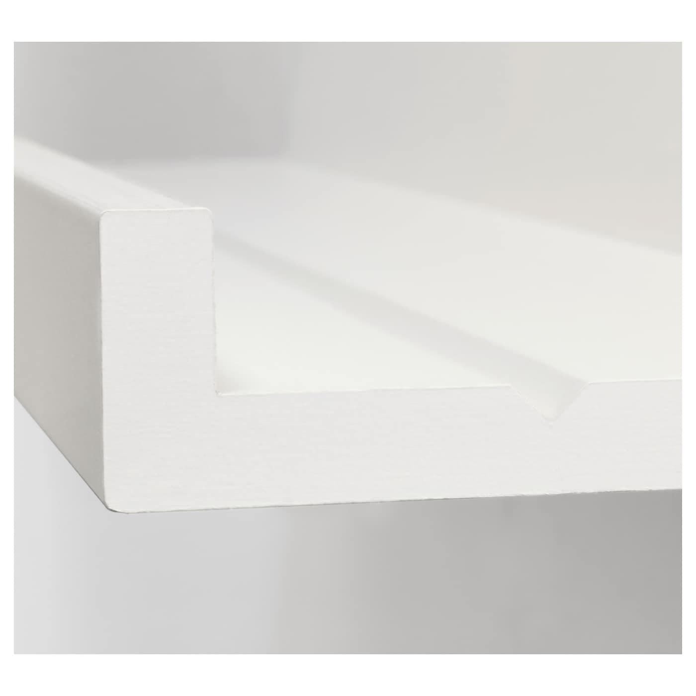 Ein Ablagetisch aus zwei MOSSLANDA Bilderleisten in Weiß