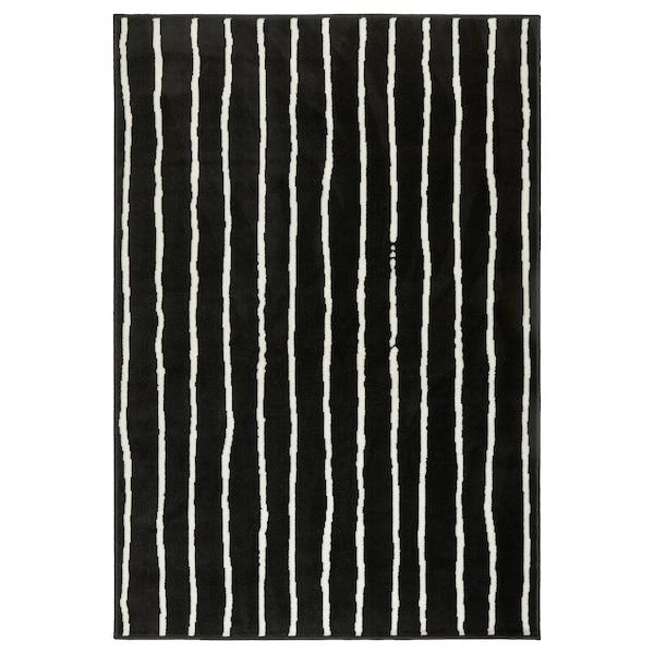 GÖRLÖSE rug, low pile black/white 195 cm 133 cm 10 mm 2.59 m² 1450 g/m² 350 g/m² 7 mm 8 mm