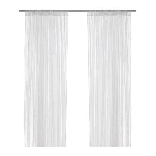 LILL Net curtains, 1 pair IKEA The net curtains let the daylight through but provide privacy so they are perfect to use in a layered window solution.