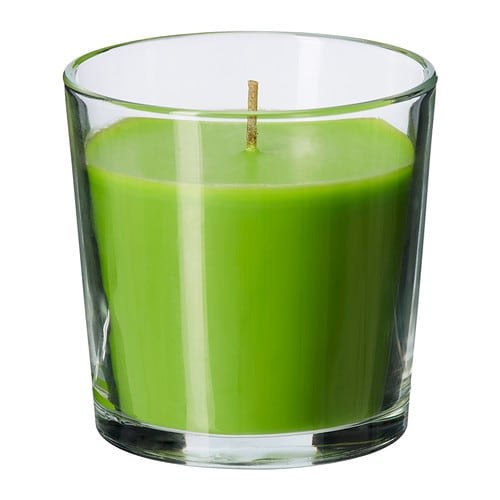 SINNLIG Scented candle in glass IKEA Creates atmosphere with a pleasant scent of crisp apple and warm candlelight.