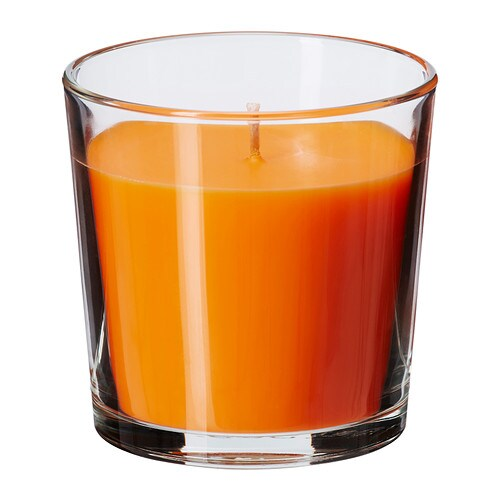SINNLIG Scented candle in glass IKEA Creates atmosphere with a pleasant scent of tangerine sunshine and warm candlelight.