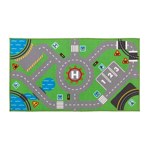 STORABO Rug IKEA Honk and drive! On this rug there are roads, parking spaces, traffic signs and railroads – just like in a city.
