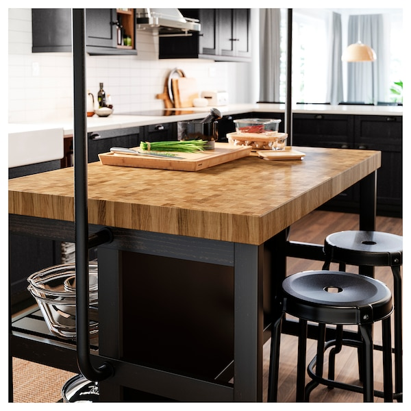 VADHOLMA Kitchen island with rack, black/oak, 126x79x193 cm