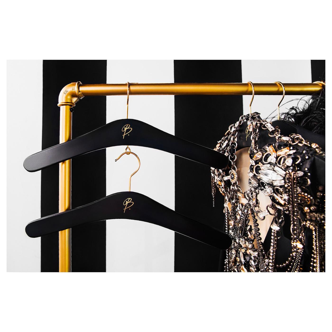 omedelbar cintre courb noir couleur or ikea. Black Bedroom Furniture Sets. Home Design Ideas
