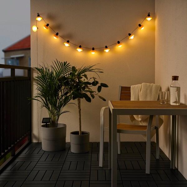 SOLVINDEN Led-lichtsnoer met 12 lampjes, buiten op zonnecellen/minilantaarn beige