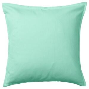 لون: أخضر فيروزي فاتح.