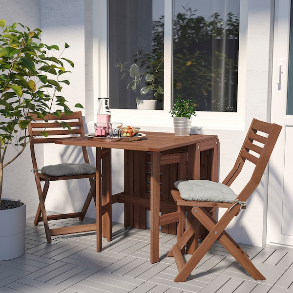 ÄPPLARÖ Table+2 folding chairs, outdoor, brown stained/Kuddarna grey