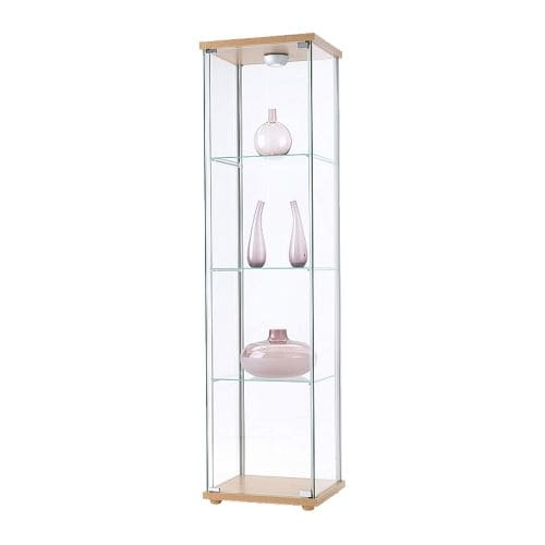 DETOLF Glass-door cabinet   A glass-door cabinet displays and protects your glassware, favorite collectables, etc.
