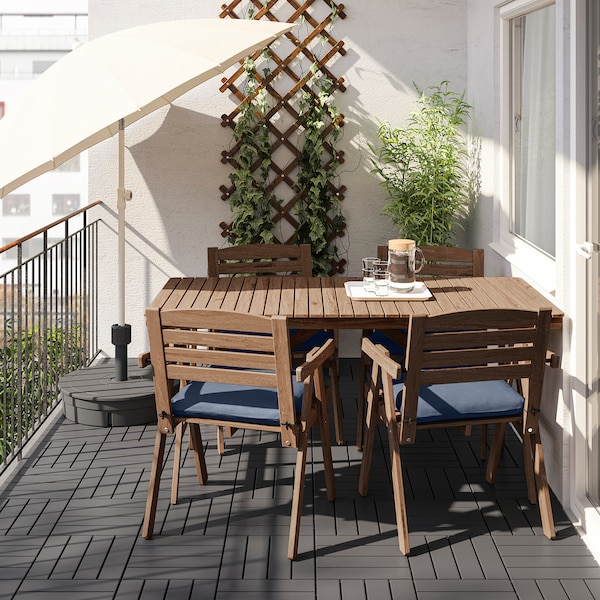 FALHOLMEN Table and 4 armchairs, outdoor, light brown stained/Frösön/Duvholmen blue
