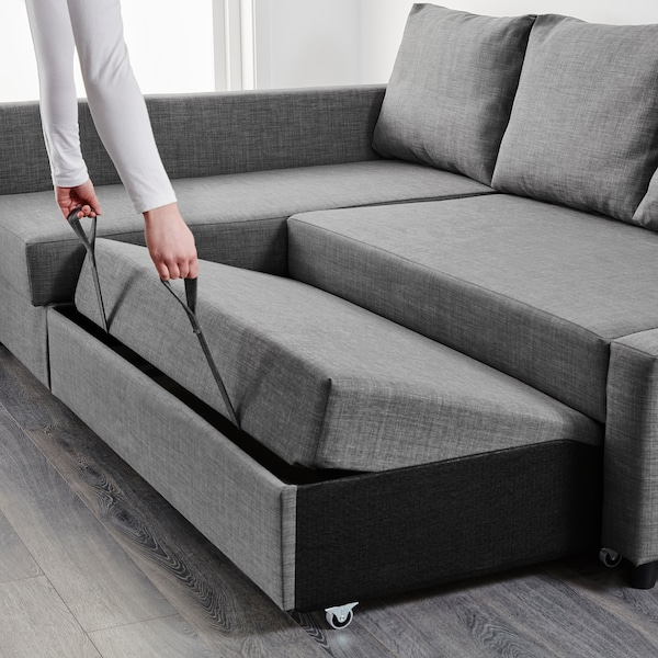 Corner sofa-bed with storage FRIHETEN Skiftebo dark gray
