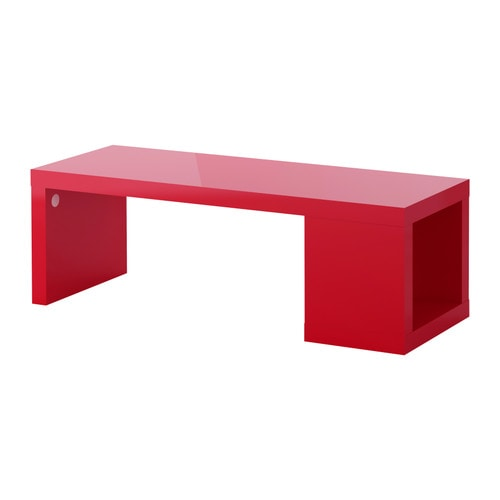 LACK Coffee table   The high-gloss surfaces reflect light and give a vibrant look.  One open compartment for storing magazines, remotes etc.