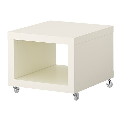 LACK Side table on casters   Includes casters, making it easy to move.  One open compartment for magazines and remote controls, etc.