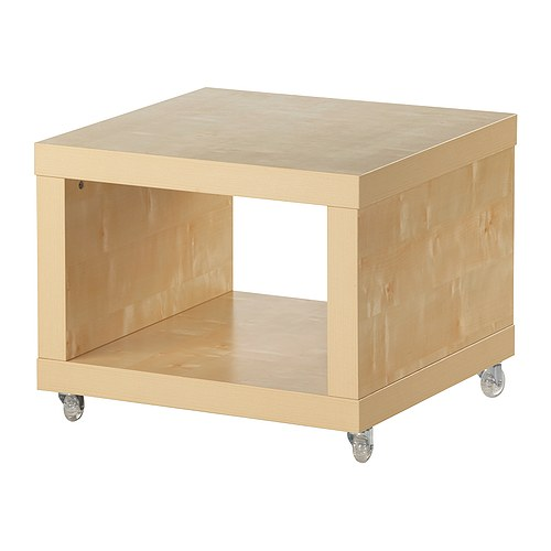 LACK Side table on casters   Includes casters, making it easy to move.  One open compartment for storing magazines, remotes etc.