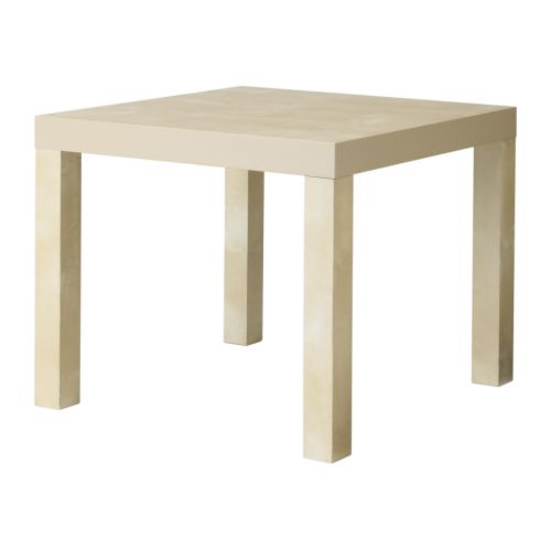 LACK Side table   Easy to assemble.  Lightweight and easy to move.