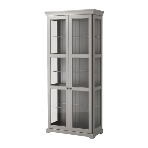LIATORP Glass-door cabinet   3 adjustable glass shelves.    Adjust spacing according to your storage needs.