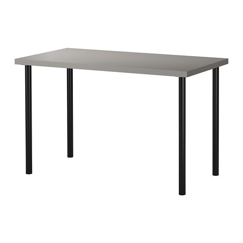 LINNMON / ADILS Table   Adjustable feet allow you to level the table on uneven floors.  Pre-drilled leg holes for easy assembly.