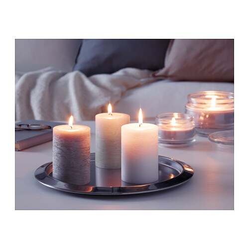 LUGGA Scented block candle   Creates atmosphere with a pleasant scent of soft vanilla and warm candlelight.