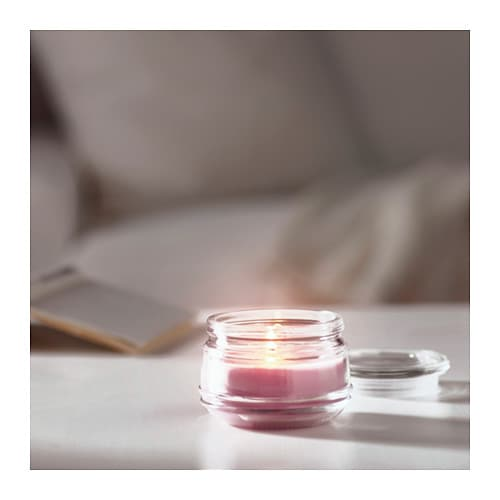 LUGGA Scented candle in glass   Creates atmosphere with a pleasant scent of blossoming romance and warm candlelight.