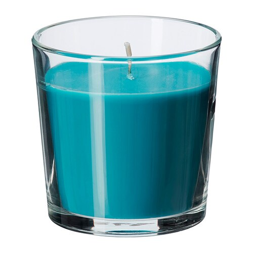 SINNLIG Scented candle in glass   Creates atmosphere with a pleasant scent of beach breeze and warm candlelight.