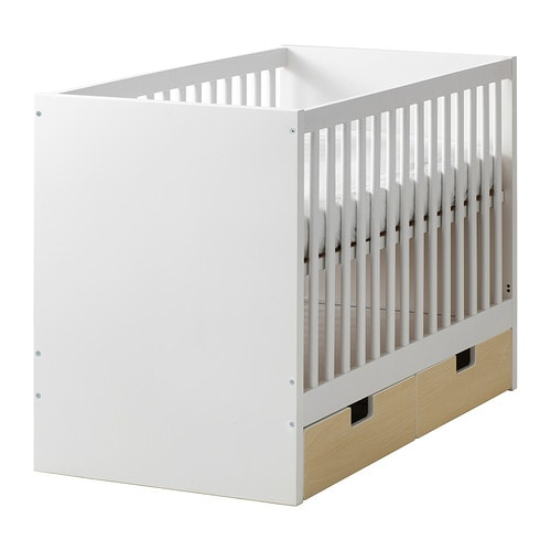 STUVA Crib with drawers   The bed base can be placed at two different heights.