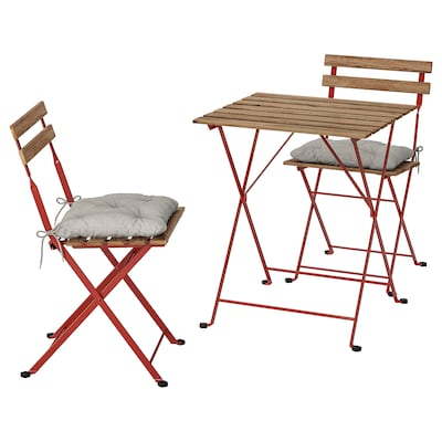 TÄRNÖ Bistro set, outdoor, red/light brown stained/Kuddarna gray