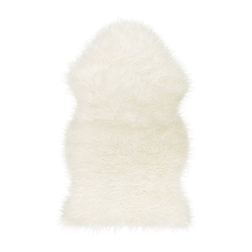 TEJN Faux sheepskin   The faux sheepskin is super soft, warm and cozy.   Ideal as a rug or draped across your favorite armchair.