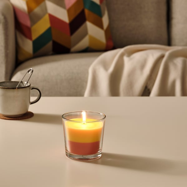 FORTGÅ Scented candle in glass, Bananas/orange/yellow, 9 cm