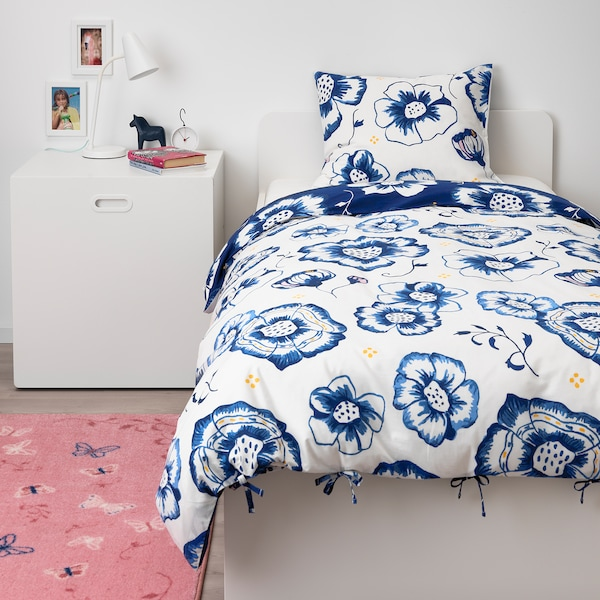 SÅNGLÄRKA Copripiumino e federa, fiore/blu scuro bianco, 150x200/50x60 cm