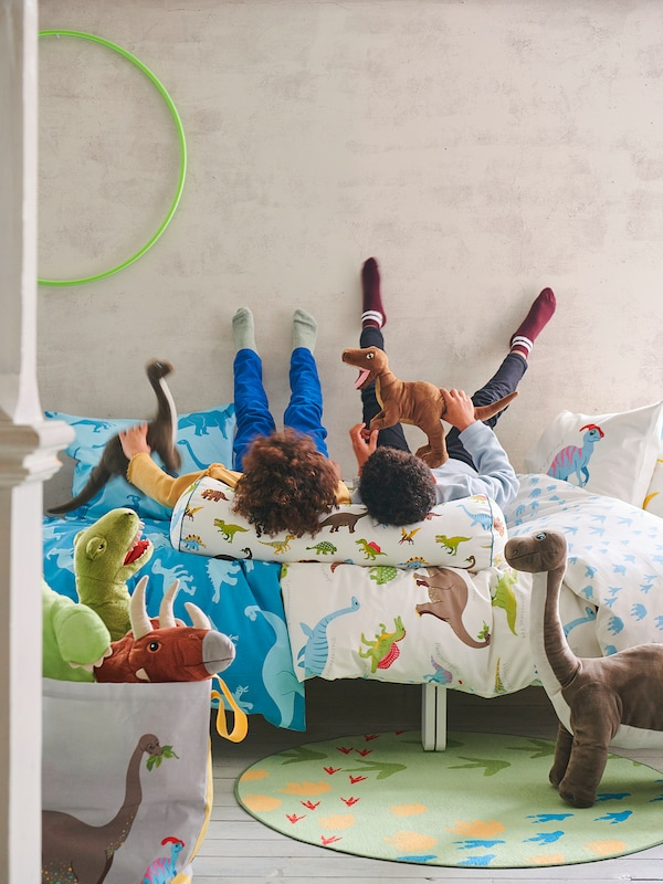 JÄTTELIK Polštář, dinosaurus/barevné, 80 cm