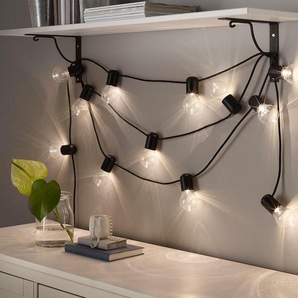SVARTRÅ Osvětlovací řetěz LED se 12 světly, černá/venkovní