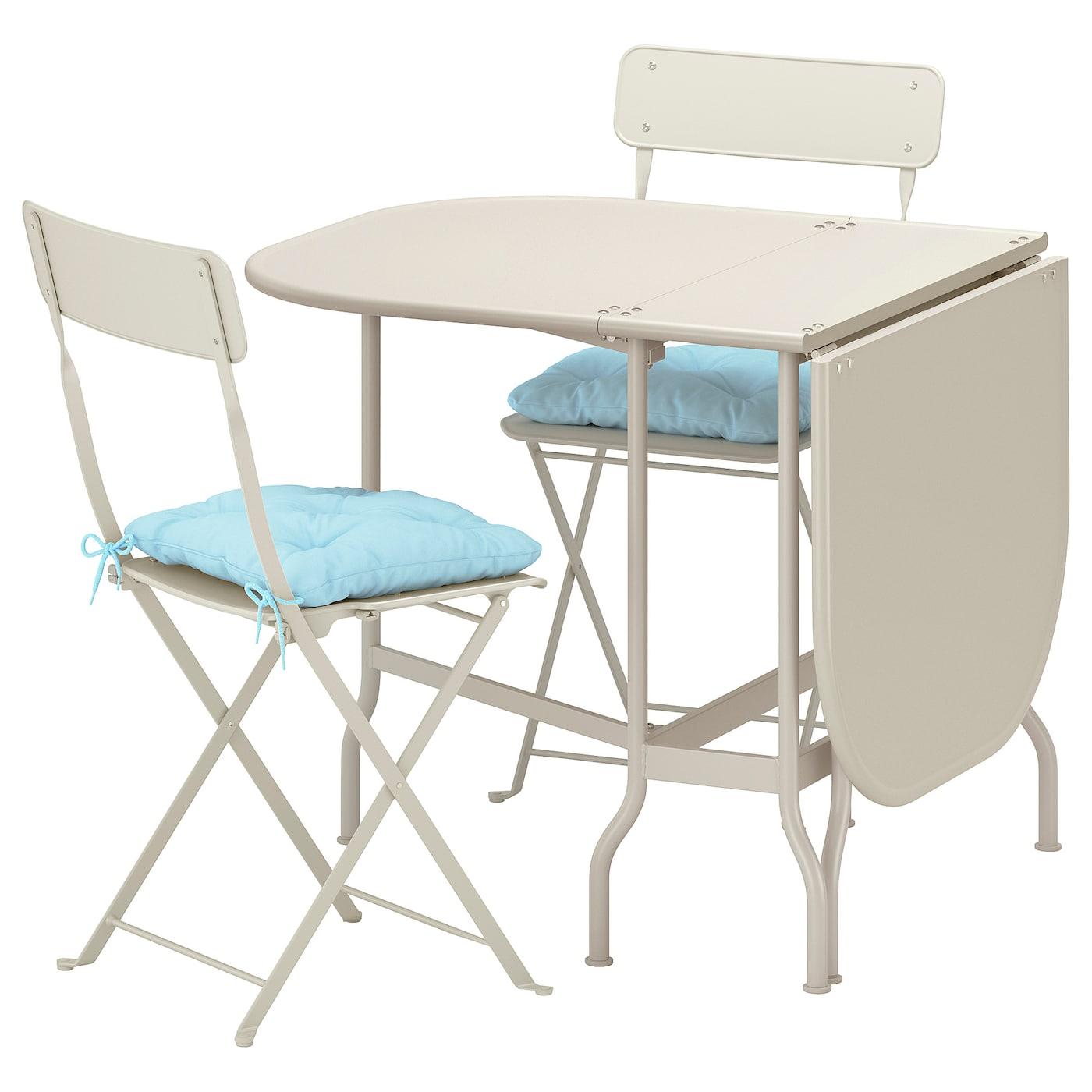 IKEA SALTHOLMEN Tisch+2 Klappstühleaußen beigeKuddarna hellblau