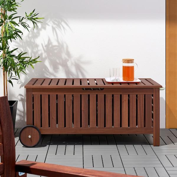 ÄPPLARÖ Bænk med opbevaring, ude, brun bejdse, 128x57 cm