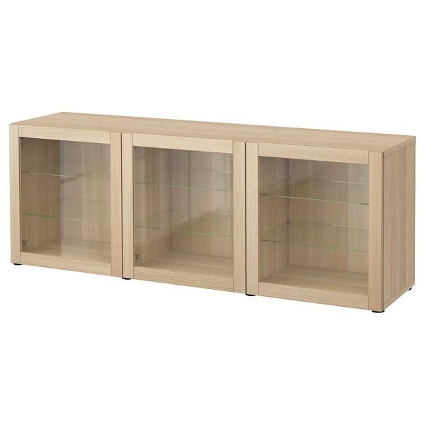 BESTÅ Opbevaring med låger, egetræsmønster med hvid bejdse/Sindvik egetræsmø hvid bejd/klart glas, 180x42x65 cm