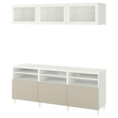 BESTÅ Tv-møbel med vitrinelåger, hvid Sutterviken/gråbeige klart glas, 180x42x192 cm