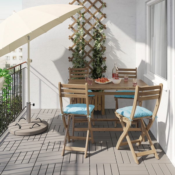 ASKHOLMEN Table+4 folding chairs, outdoor, grey-brown stained/Kuddarna light blue