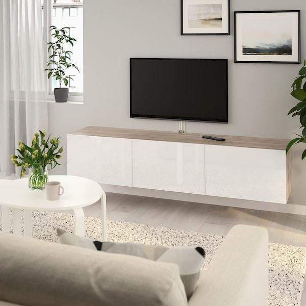 BESTÅ طاولة تلفزيون مع أبواب, مظهر الجوز مصبوغ رمادي/Selsviken أبيض/لامع, 180x42x38 سم
