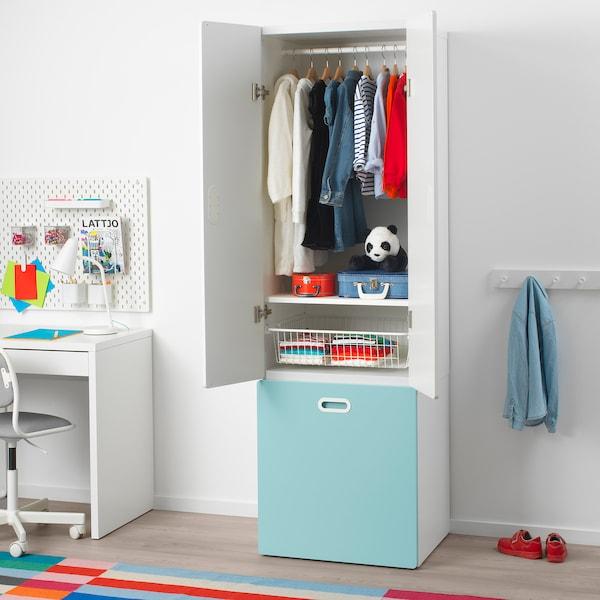 STUVA / FRITIDS دولاب ملابس مع مخزن للألعاب, أبيض/أزرق فاتح, 60x50x192 سم