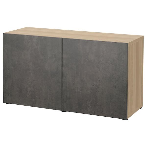 BESTÅ Emmagatzematge amb portes, efecte roure tenyit blanc Kallviken/gris fosc efecte ciment, 120x42x65 cm