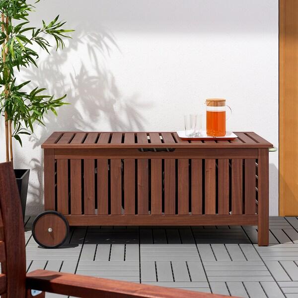 ÄPPLARÖ Banco jardín con almacenaje, tinte marrón, 128x57 cm