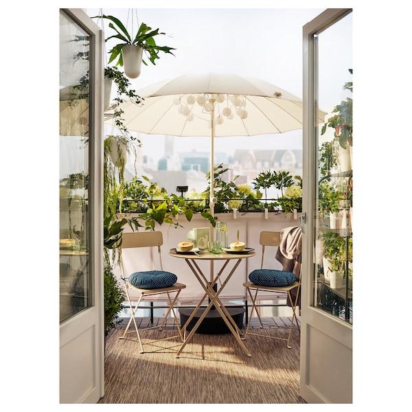 SALTHOLMEN Mesa jardín, plegable beige, 65 cm
