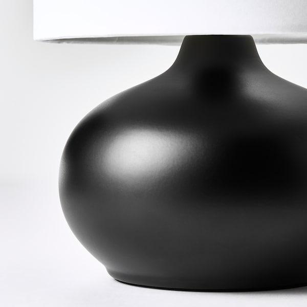 TVÄRFOT Lámpara de mesa, negro/blanco
