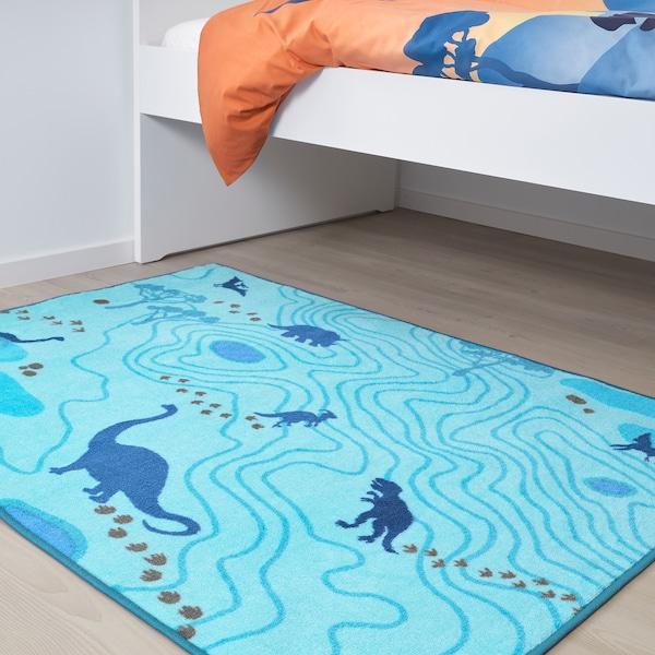 JÄTTELIK Alfombra, silueta dinosauro/azul, 100x133 cm
