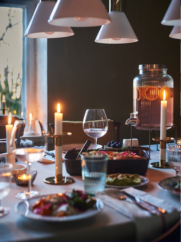 Dark dining room setting with candle lit dinner set