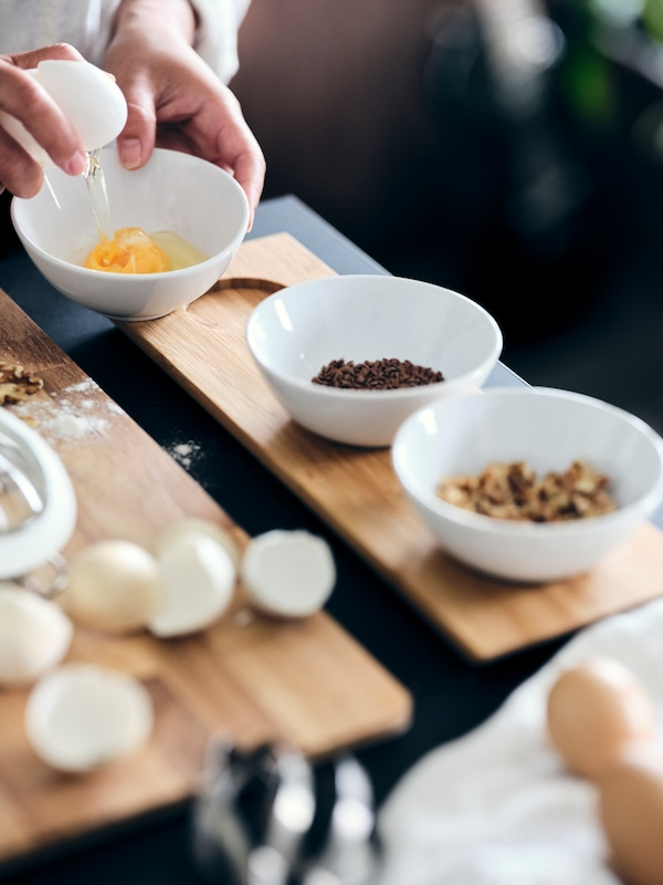 A close-up of small white bowls on a chopping board in the kitchen, just preparing ingredients for the meal.